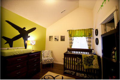 Modern green and brown airplane theme nursery room decor