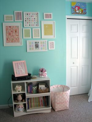 Baby nursery wall art arrangment.  The white picture frames look so clean on the aqua wall paint.