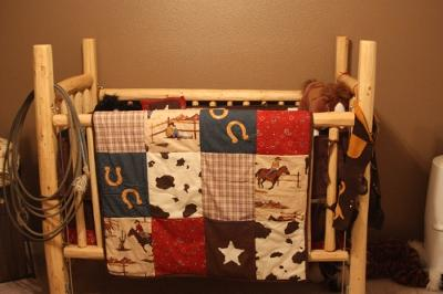 Rustic western baby crib that we made, cabin style, from pine logs for our little cowboy
