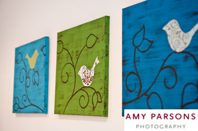 Homemade bird wall art made from canvas craft paint and fabric appliques