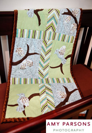 Homemade patchwork bird theme baby crib quilt with appliques and chevon stripes border