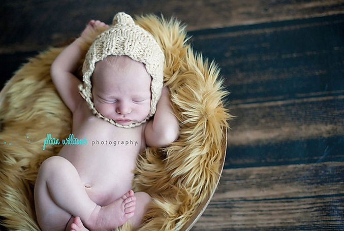 An old-fashioned vintage style baby pixie hat knitting pattern knit with chunky yarn.  The bulky yarn makes this a fast and easy pattern for beginners that works up quick