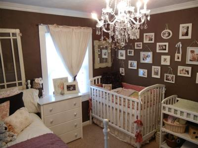 A gallery picture wall in a chocolate brown baby girl shabby chic nursery made of vintage photo frames in many sizes