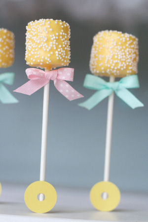 Yellow and blue decorated April baby shower marshmallow pops