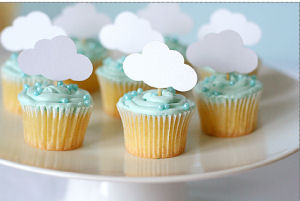 April baby shower cloud rain theme cupcakes with edible blue pearls and paper party cut outs