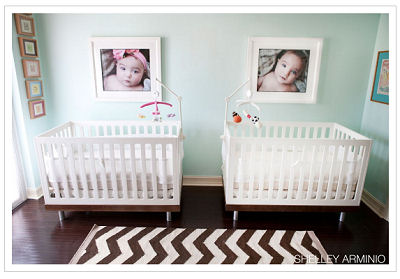 Oeuf Classic cribs in walnut in an aqua nursery decorated for a twin boy and girl