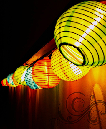 Asian party decorating ideas with paper lanterns and patio lights
