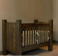 A rustic baby crib made from reclaimed wood