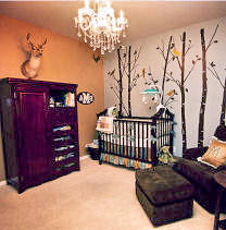 A  nursery decorated in earth tones with a hunting trophy used as wall decorations