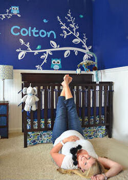 Owl baby nursery with navy blue walls and name decal