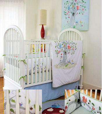 Baby bedding with forest creatures squirrels acorns birds and a tree with leaves sheltering the baby animals