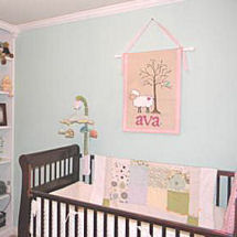 Decorated sweet little lamb baby girl nursery room theme in pink and blue