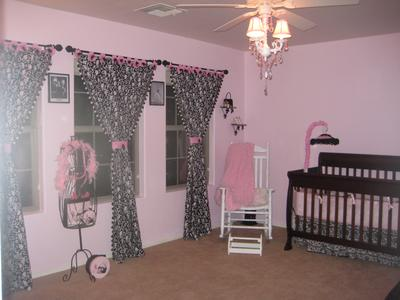 A view of our baby girl's pink and black nursery and her chandelier
