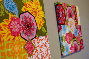 Brightly colored homemade fabric wall art squares for a baby girl's nursery