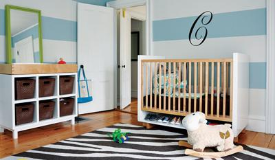 Modern baby blue and white nursery room decor with horizontal wall stripes