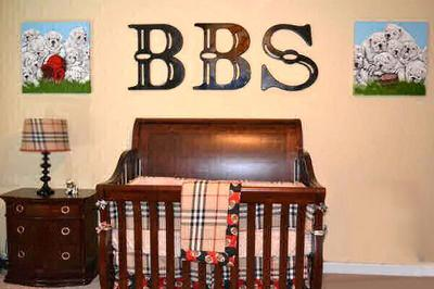 Football sports theme nursery for a baby boy with a Burberry plaid crib bedding set and wooden wall letters by Murals & Things by Jamie