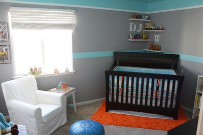 Our baby boy's jungle safari nursery is bubbling with color and fun with some modern elements; an infant's private playground