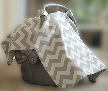 Baby car seat carrier cover that buttons onto the handle of your baby carrier made using a grey and white chevron pattern fabric