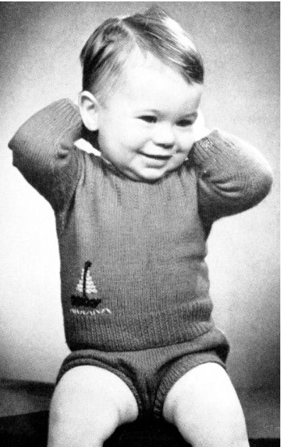 Free baby slipover sweater knitting pattern tutorial for a boy with sailboat embroidery.