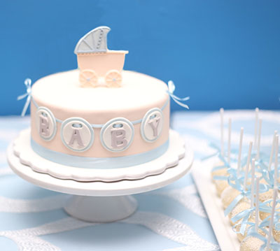 Homemade baby carriage baby shower cake picture idea for a boy party with decorations