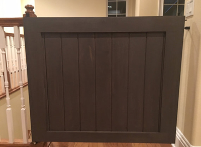 Wood baby gate top of stairs