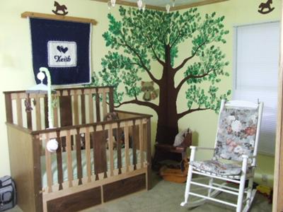Baby Keith's unique nursery with homemade baby crib made from hardwoods including maple, oak, and black walnut woods that dad dovetailed.