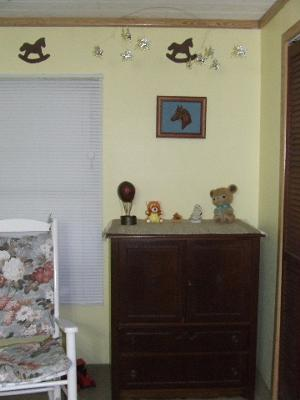 The stenciled rocking horse wall border over the baby dresser that was mom's.