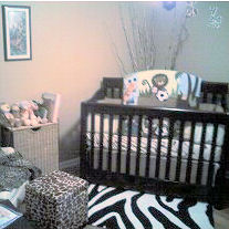 A baby nursery with a zebra print rug in front of the crib