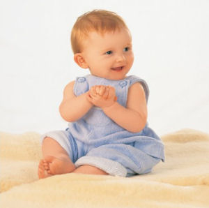 Real unshorn baby sheepskin rug used as a baby portrait photo prop