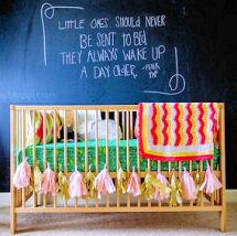 Baby nursery with DIY crafts projects tassels blackboard art wall