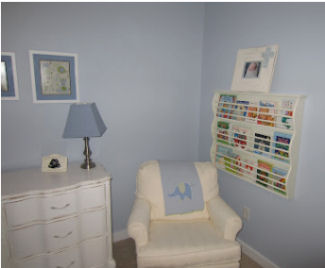 Wooden book rack for a baby nursery room wall