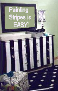 Baby dresser changer painted in black and white stripes with glass knobs
