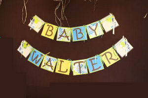 Homemade beach theme baby shower banner for a baby boy made from tropical print paper