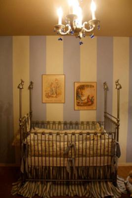 Beatrix Potter Nursery Bedding and Decor.  I love the way the baby's crib looks with the blue and white striped walls and the artwork.