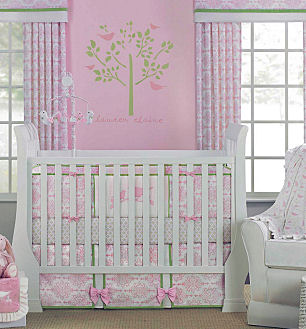 Pink and grey bird theme nursery ideas for a girl with bird baby bedding set in a white crib