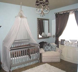 Chocolate brown and baby blue boy nursery with canopy crib