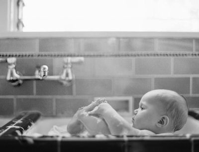 Black and white newborn baby bathtime baby photo shoot
