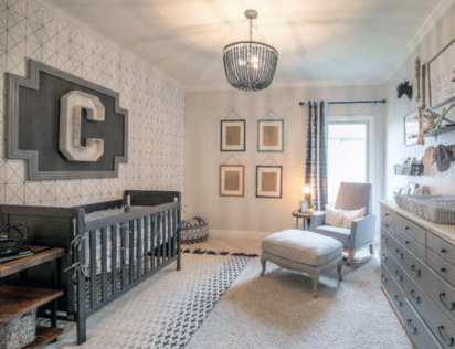 Bright black and white masculine baby nursery room for a boy