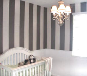 Baby girl nursery walls with a brown and pink paint color scheme and stripes painting technique