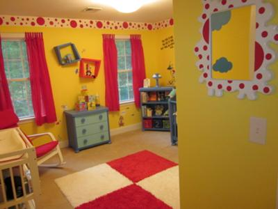 Our baby boy's Dr Seuss nursery with bright yellow walls and red white and blue decorations