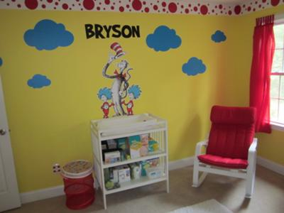 Our baby boy's name, blue cloud shaped wall decals, Cat in the Hat and Thing One and Thing Two are the focal point of the nursery over our baby boy's changing table.