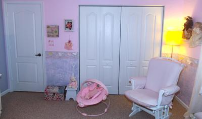 Our baby girl's nursery closet features pretty bins and baskets to use for storage.