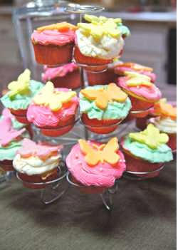 Cupcakes for a baby girl shower decorated with fondant butterflies