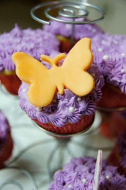 Purple baby girl shower cupcakes with fondant butterflies decorations