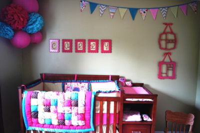 Pink owl nursery theme with custom owl baby bedding set in pink and blue for a girl