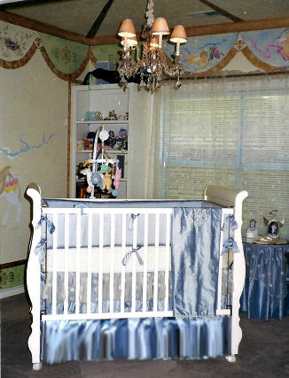 Carousel horse baby nursery theme room for a baby boy with custom wall mural created by Lynda Bergman
