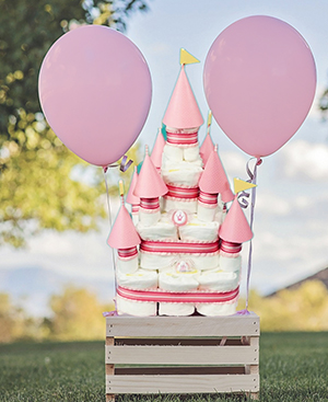 Princess castle diaper cake for a girl baby shower party.