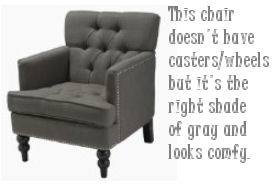 Charcoal gray tufted armchair for a baby nursery