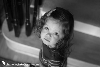 Black and white photo of a little girl by Charlotte Photography