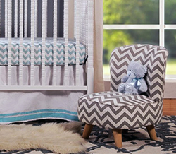 Baby boy chevron nursery ideas in blue gray and white with a recycled upholstered chair.